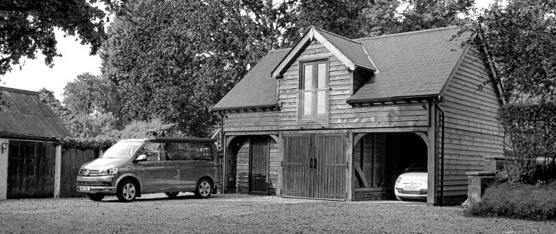 3 car oak garage with guest accommodation above.